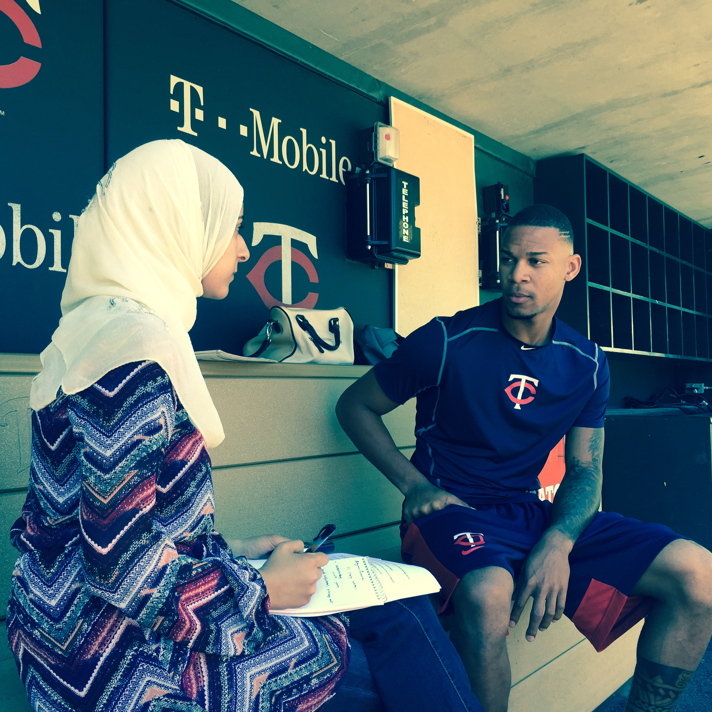 student interviewing a Twins player