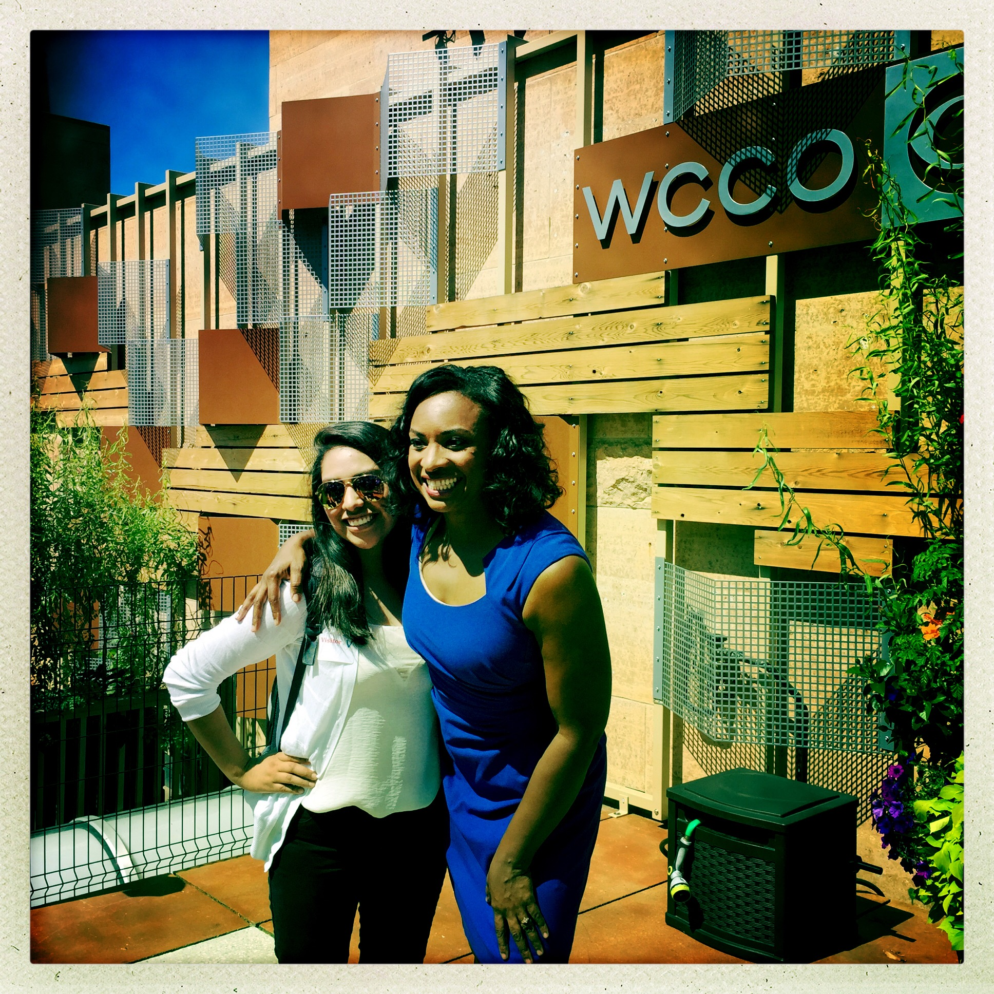 student with Angela Davis outside WCCO studio