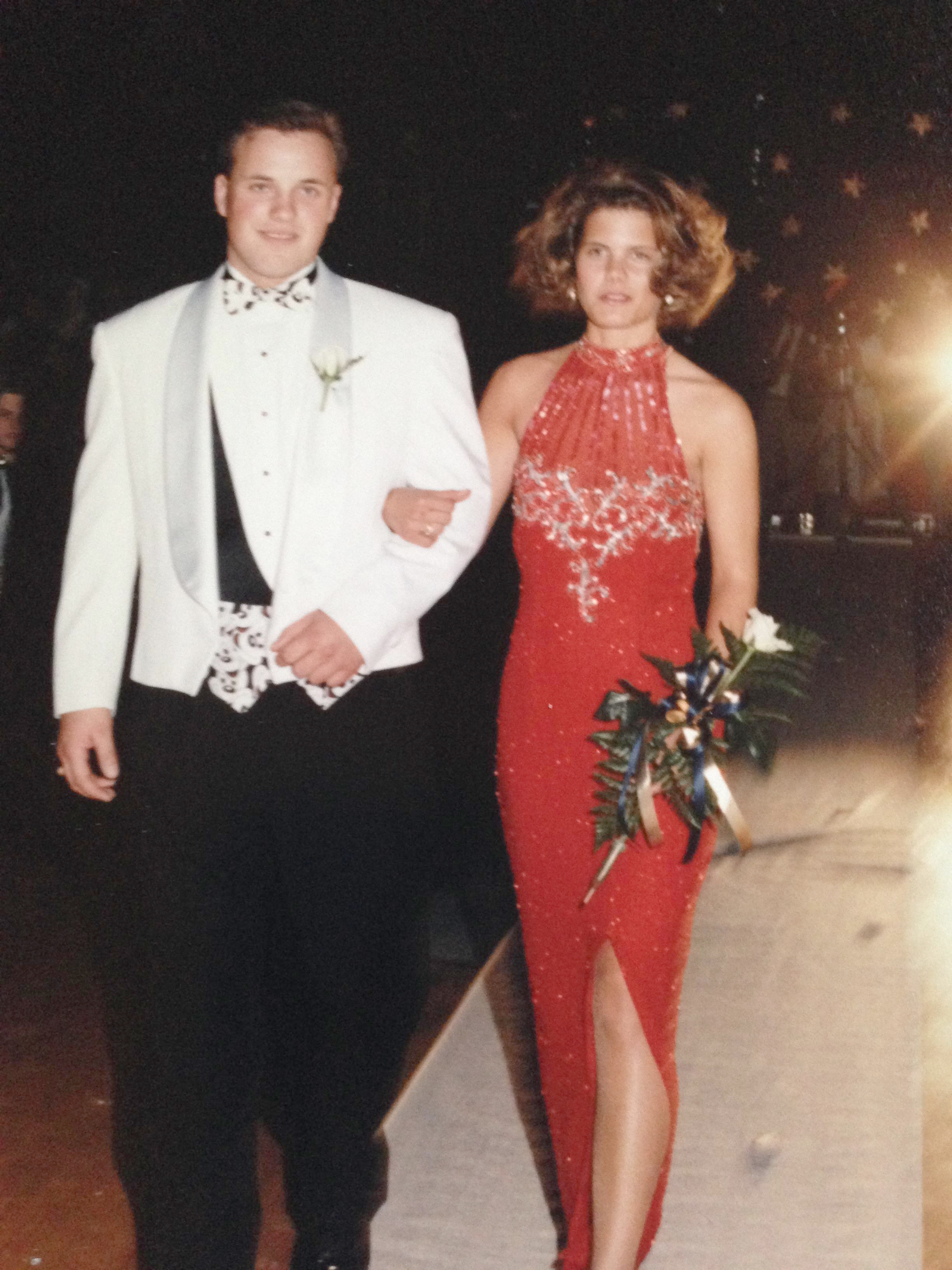 Jana Shortal as prom queen with a male prom goer on her arm