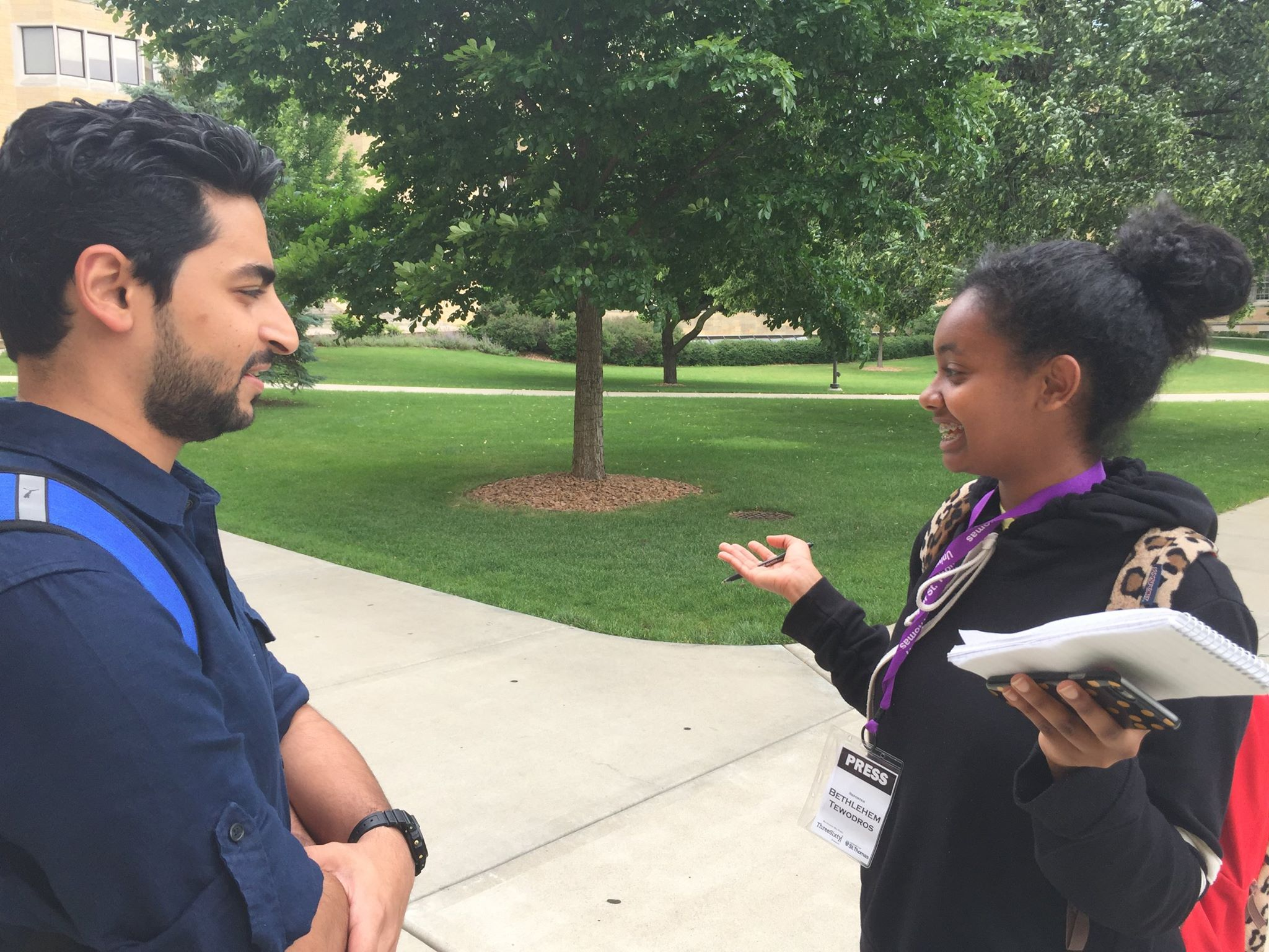 ThreeSixty Journalism student talks to program volunteer.