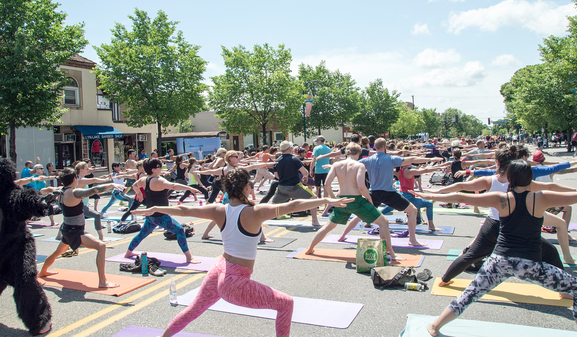 People perform yoga in the middle of Lyndale Avenue during an Open Streets event.