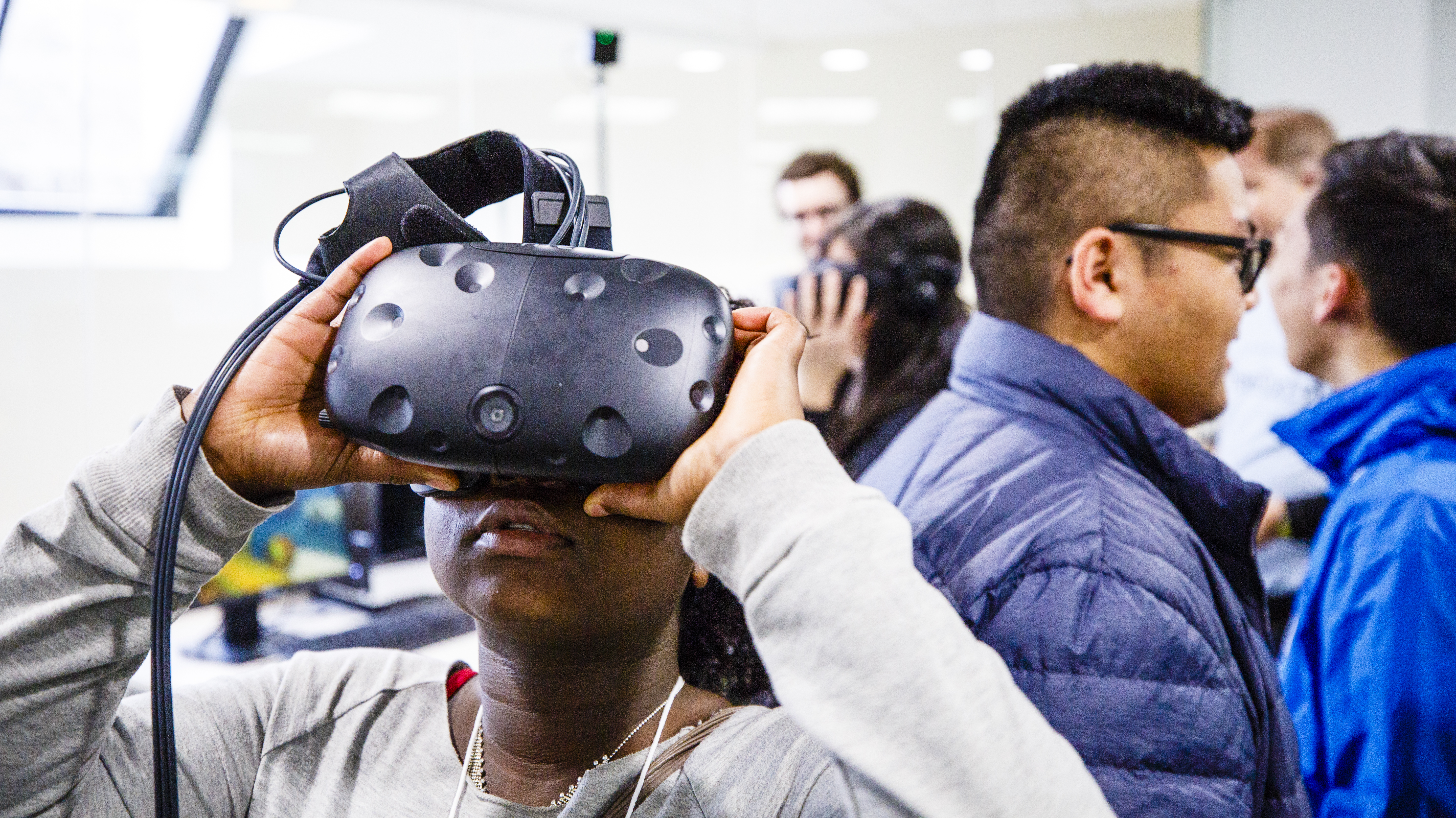 A student uses virtual reality at the Youth Digital Media Summit in February.