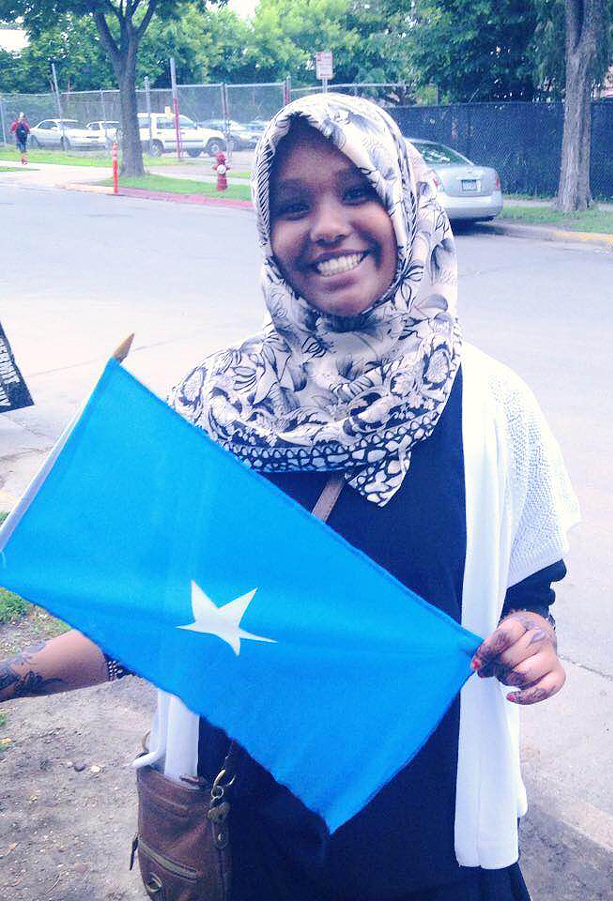 young Muslim woman with Somali flag