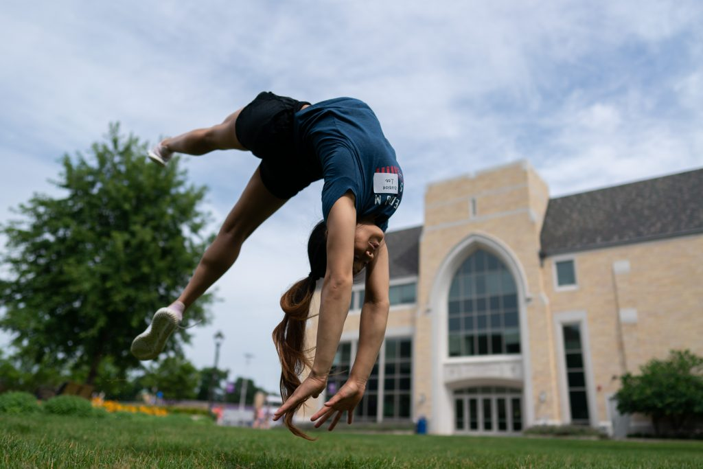 Hmong gymnast Sunisa Lee performs a stunt at the University of St. Thomas in St. Paul. (Courtesy Mark VanCleave)