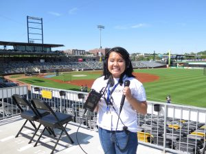 A student holds recording equipment at CHS Field