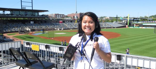 A student holds recording equipment at CHS Field during ThreeSixty's 2018 Radio Camp