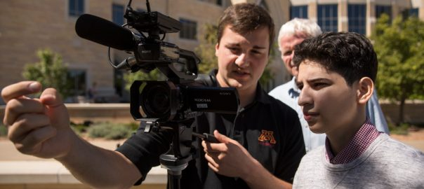 Roseville Area High School student Jessy Saybe, right, receives guidance from University of Minnesota journalism student Ryan Russell on the north campus during the ThreeSixty Journalism program on July 24, 2018 in St. Paul.