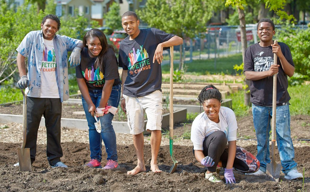 Young people in Appetite for Change pose for a photo in a garden. The organization uses food as a tool for change in north Minneapolis. (Photo courtesy of Appetite for Change)