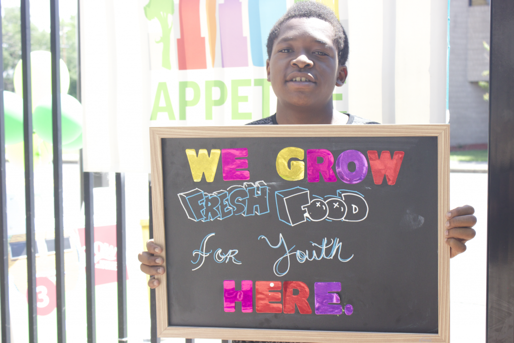 Youth involved in Appetite for Change encourages North Minneapolis community members to shop fresh.