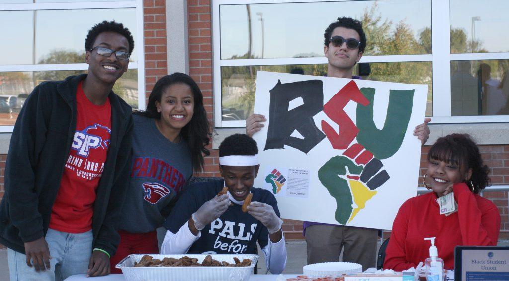 Members of the Spring Lake Park Black Student Union sell chicken as a fundraiser during Homecoming Week. (Submitted photo)