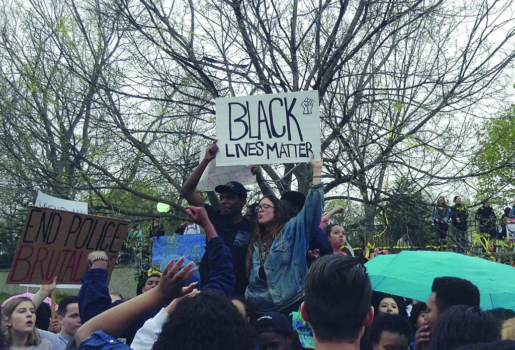 "Protesters gathered on May 1 in Martin Luther King Park in Minneapolis, carrying signs and chanting, ""No justice, no peace, prosecute the police!"""