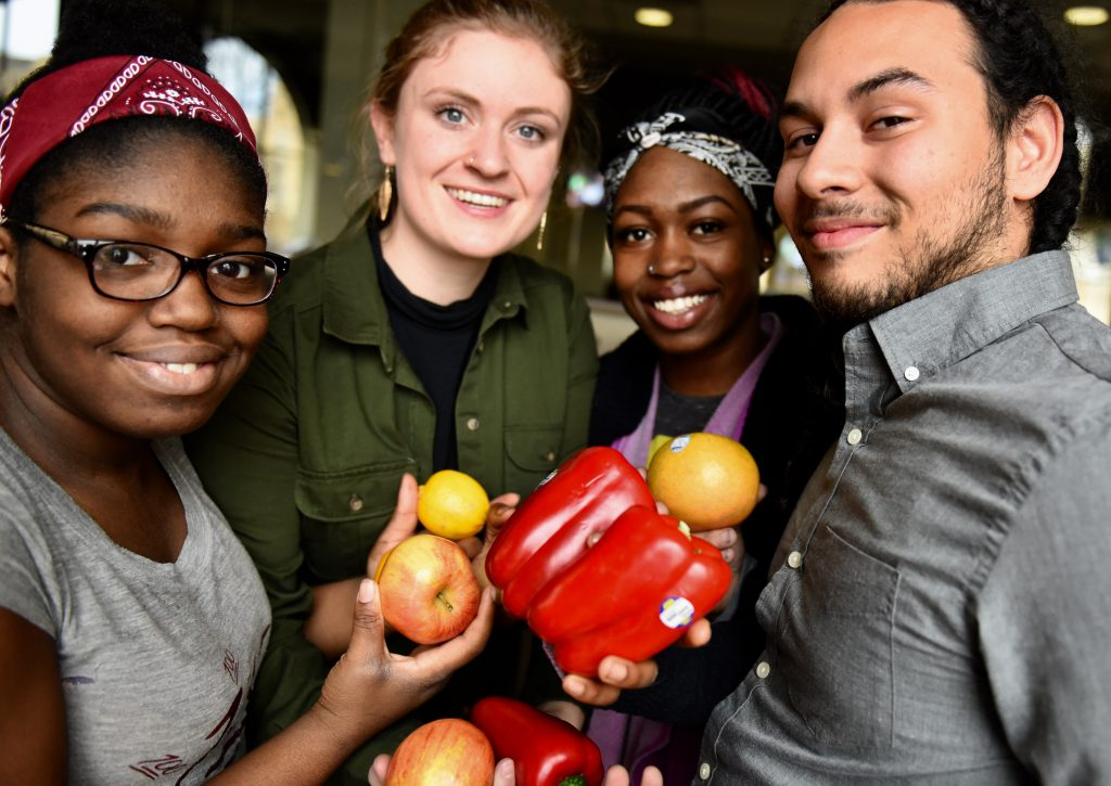 Young people involved in BrightSide Produce, including Adam Pruitt (right) and Demetria Fuller (second from right), who co-founded BrightSide Produce with University of St. Thomas professor Adam Kay. (Mychaela Bartel/ThreeSixty Journalism)
