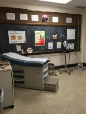 clinic room with a bed