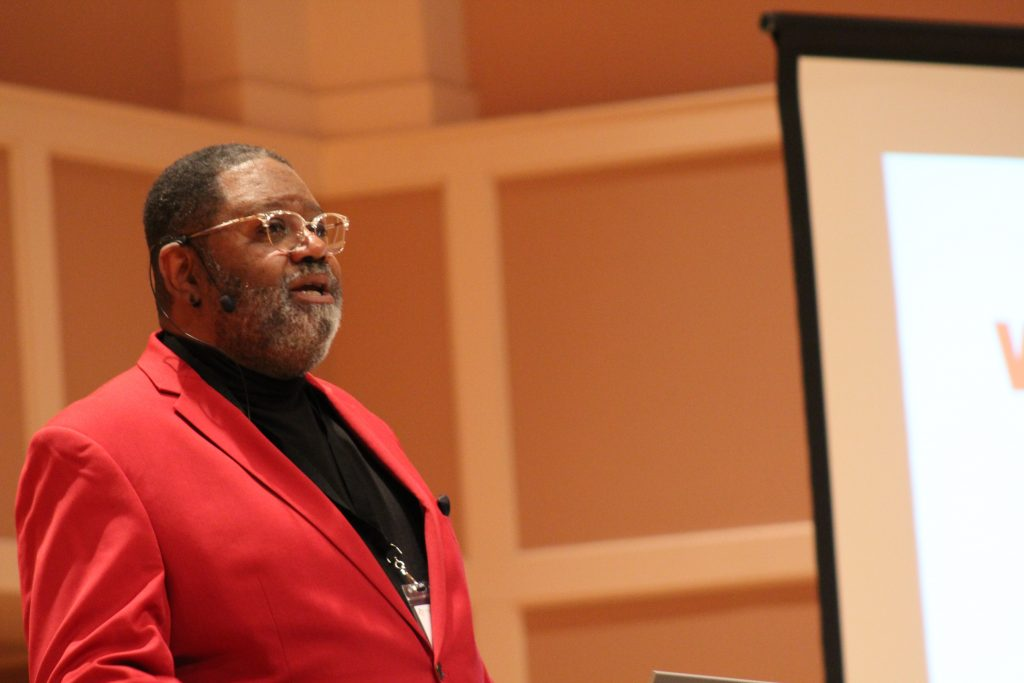 Sam Simmons delivers the keynote at day one the Truth and Transformation: Changing Racial Narratives in Media conference Tuesday, March 19, at Hamline University