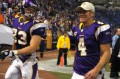 Brett Favre and another Viking walking off the field.