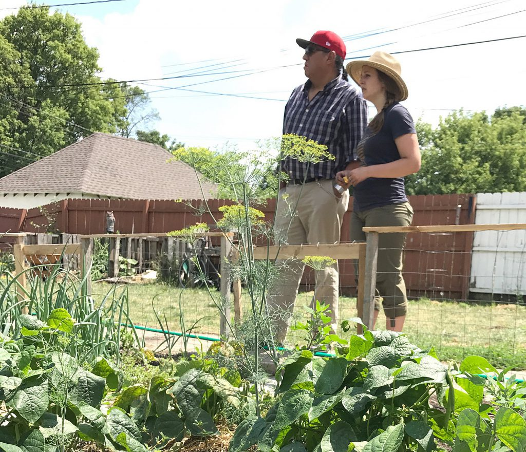 The Rev. Canon Robert Two Bulls (left), founder of First Nations Kitchen, and Claire Baglien, Gandhi Mahal Interfaith Garden coordinator, survey the garden.