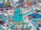 Colorful Graffiti on a wall depicting a blue person with a boombox and cars