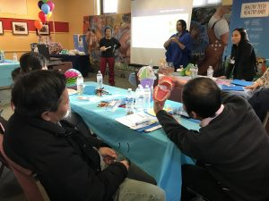 State Oral Health Director, Prasida Khanal and her team, along with oral health educators from Community Dental Clinic-Maplewood, illustrate proper and health brushing techniques to practice with children and how to make brushing fun.