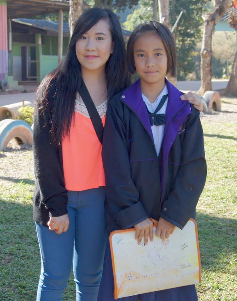 Houa Yang with her niece, Tida, in Thailand. Yang writes about how her experience in Thailand changed her outlook.