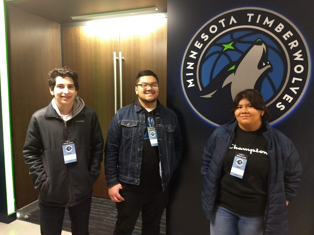 Jesse Ordoñez-Saybe, Brendan Thor and Heidi Sanchez stand outside the Timberwolves locker room where they interviewed Karl-Anthony Towns and Tyus Jones.