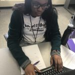 Cristo Rey High School student Nymade Fallah works on revising her essay at College Essay Boot Camp.