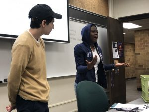 Students perform a skit on news accountability and transparency.
