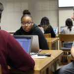 Cristo Rey High School students Isis Knights and Luis Leynes are mentored by writing coach John F.W. Thuente at College Essay Boot Camp.