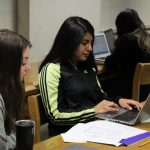 Cristo Rey Jesuit High School student Michelle Cortes-Jiménez works on her college essay with the help of writing coach Maggie LaMaack.
