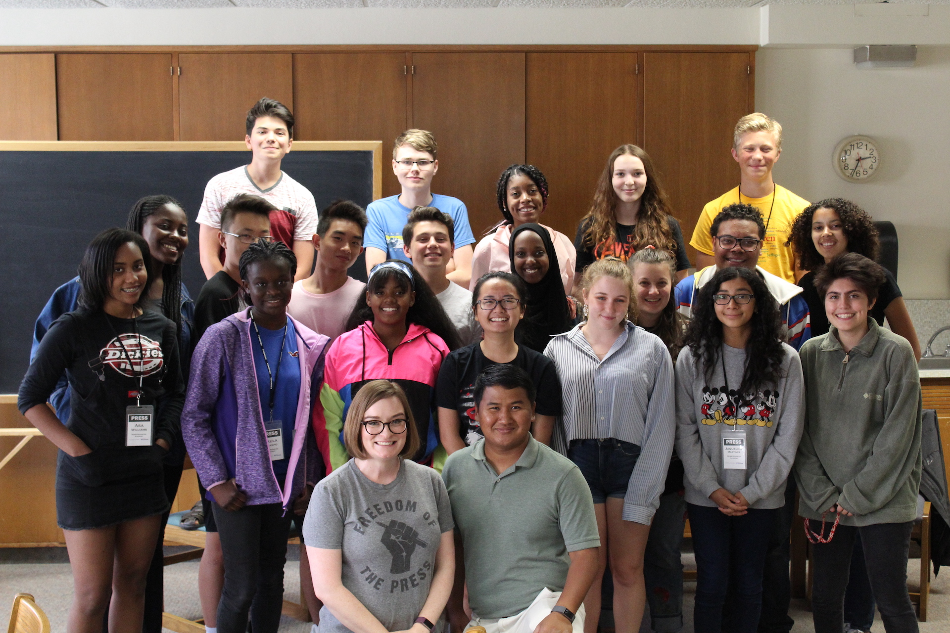 Group photo of Theresa Malloy and Dymanh Chhoun with students, 2019 summer journalism camp
