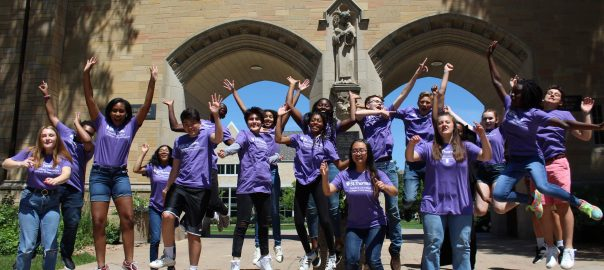 ThreeSixty News Reporter Academy students jump in front of the University of St. Thomas iconic arches.