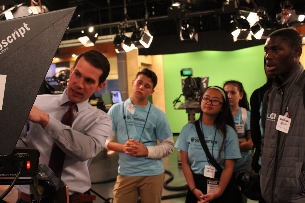 KSTP Anchor Matt Belanger shows TV Camp students the Ch. 5 studio and talks about the art of reading a teleprompter.