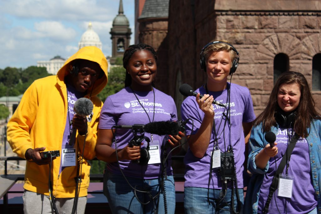 ThreeSixty students Datelle Straub, Ayo Olagbaju, Josiah Lemm and Josie Morss explore MPR's rooftop to record city sounds on the first day of Radio Camp.