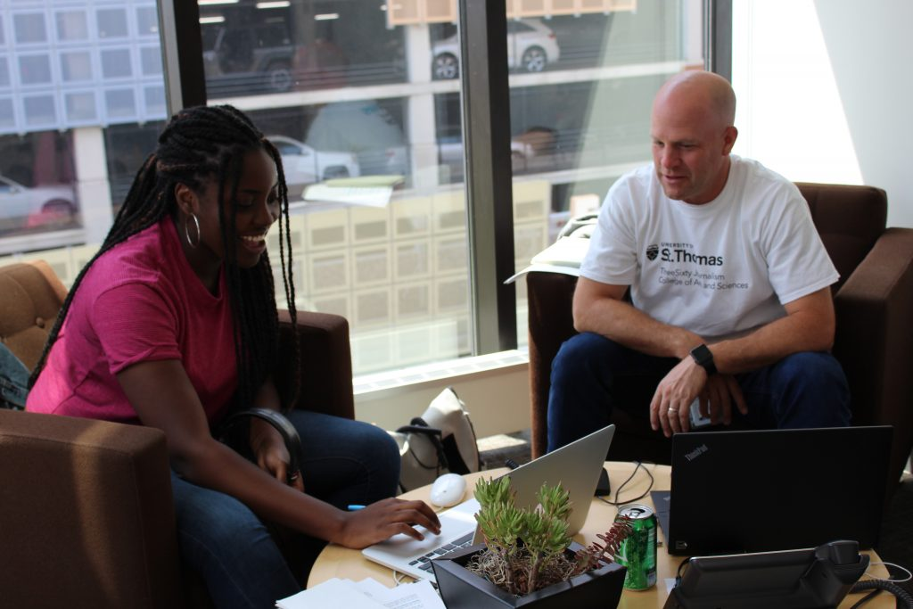 ThreeSixty's Ayo Olagbaju works with her mentor, APM Reporter Tom Scheck, to write her radio story on Juxtaposition Arts.