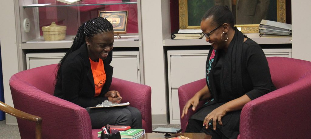 ThreeSixty student Ayomide Adesanya shares a laugh with author Edwidge Danticat during their interview.