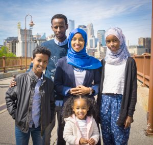 Omar and her family. (Photo courtesy of Nicholas French Portraiture)
