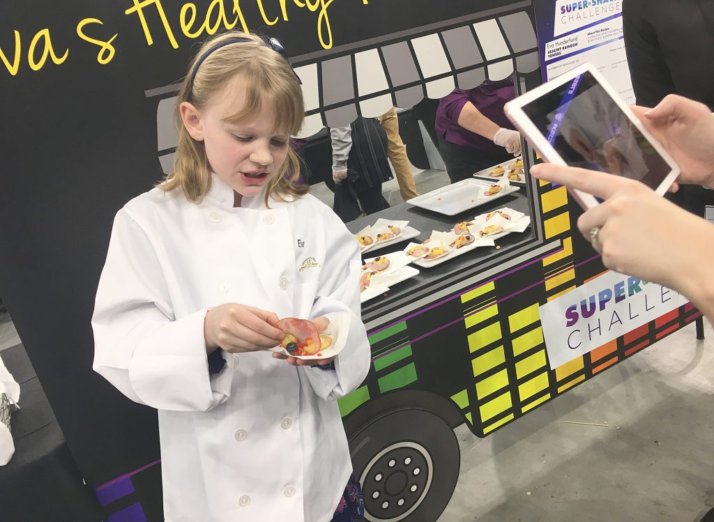 Eva Hunderfund, a 10-year-old from Rochester, was one of 10 youth chef finalists in a healthy eating competition during the Minnesota Super Bowl Host Committee's Kids Tailgate Party in January. Youth put a new twist on tailgating by serving up healthy foods during the Super Bowl week celebration. (Staff Photo)