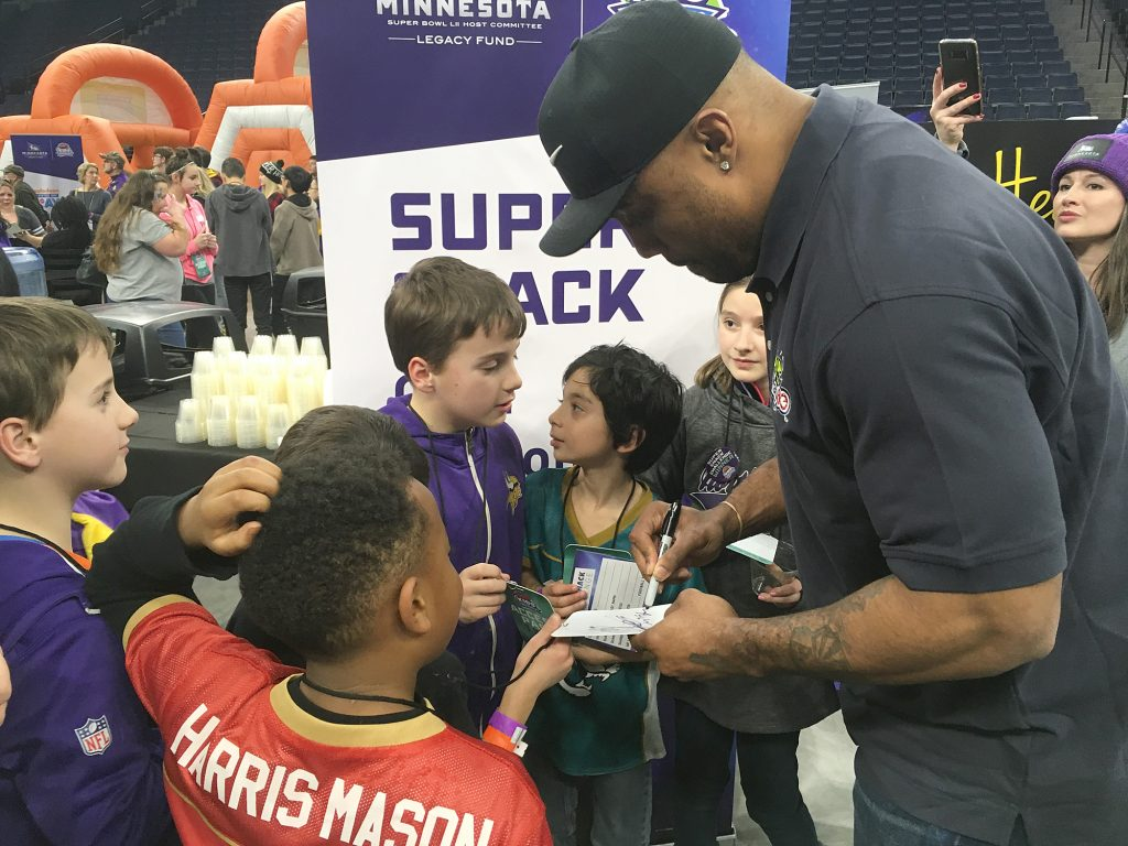 Minnesota Vikings defensive end Everson Griffen signs autographs for young people during the Kids Tailgate Party. (Staff photo)