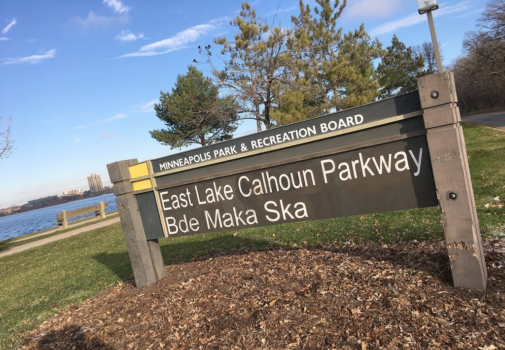 A sign on the east side of the lake in southwest Minneapolis lists both Lake Calhoun and Bde Maka Ska, the original Dakota name for the lake. The lake is part of a nationwide debate about changing the titles of monuments and landmarks named after controversial historical figures. (Staff photo)