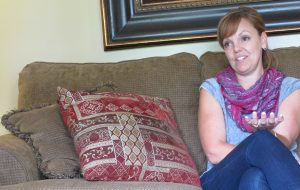 """Laura Sobiech talks about her memoir, """"Fly a Little Higher,"""" in the living room of her Lakeland home. Photo By: Tyra Davis-Jenkins"""