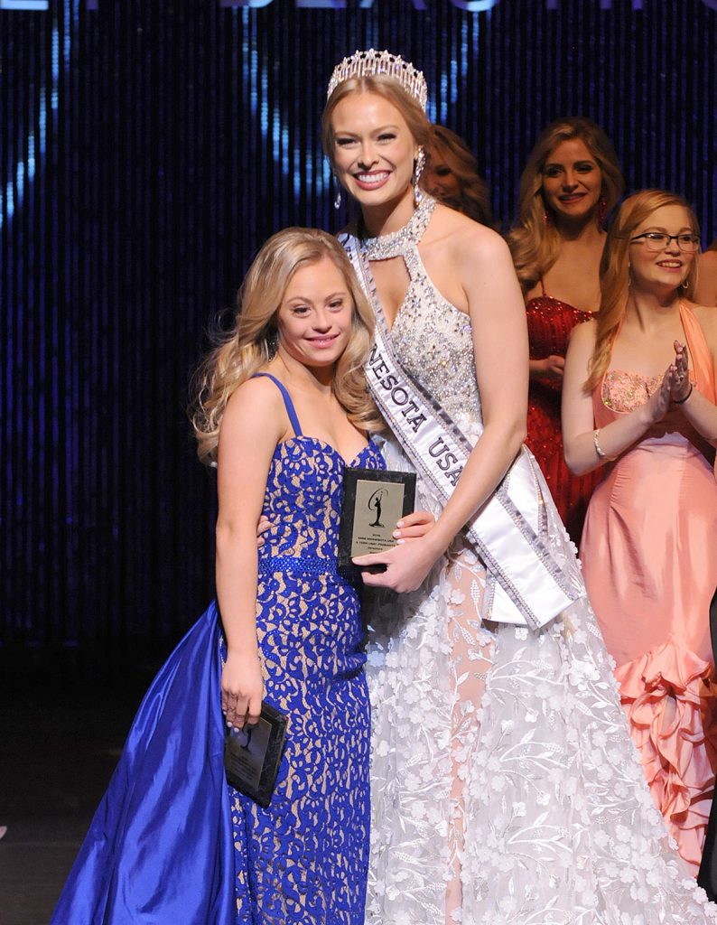 Mikayla Holmgren, a 23-year-old Bethel University, became the first person with Down syndrome to compete in the Miss Minnesota USA contest in November. Holmgren, shown with 2017 Miss Minnesota USA winner Meridith Gould, won two awards during the competition. (Photo courtesy of Future Productions, LLC)