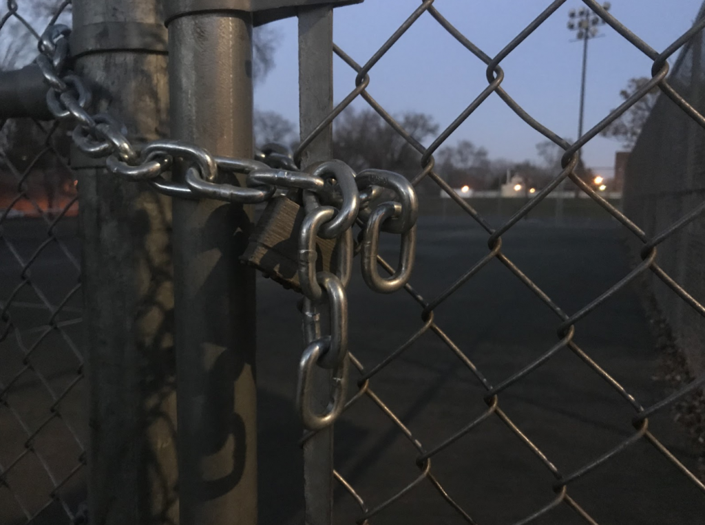 City authorities have locked down many community spaces, such as these tennis courts, to prevent the spread of COVID-19. (ThreeSixty Journalism/Evan Odegard)