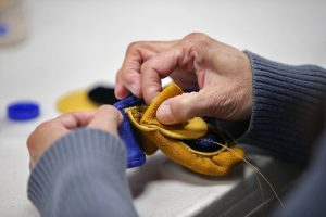 Moccasins being hand-stitched by members of The First Gift volunteer organization.