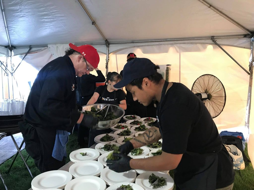 Frank Haney and staff prepare indigenous meal for catering event.