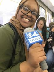 ThreeSixty Journalism student holding a WCCO microphone.