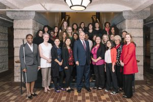 Members of the 2017-18 Young Women's Cabinet pose for a photo with Gov. Mark Dayton (front, center).