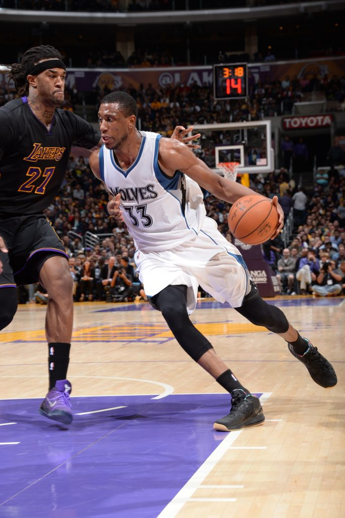 Thaddeus Young #33 of the Minnesota Timberwolves drives to the basket against Jordan Hill #27 of the Los Angeles Lakers on November 28, 2014 at Staples Center in Los Angeles, California. (Andrew D. Bernstein)